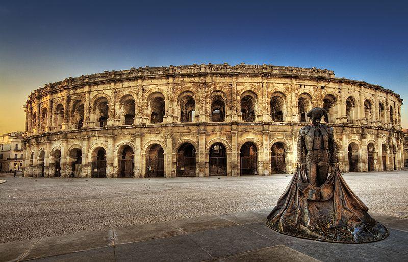 Arènes de Nîmes By Wolfgang Staudt, Germany CC BY 2.0 via Wikimedia Commons